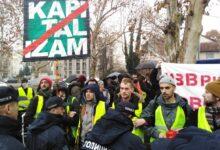 Activists protest against enforcement officers in Belgrade