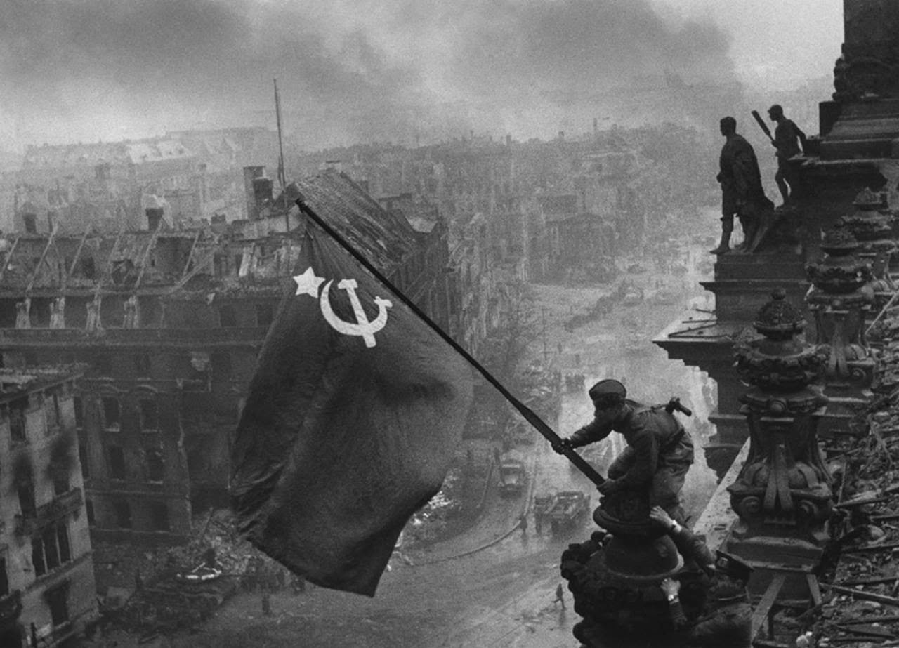 Soldiers raising the Soviet flag over the Reichstag, Berlin 1945
